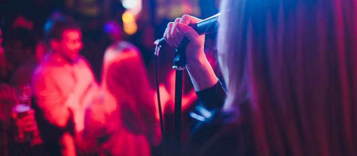 Girl singing at open mic night
